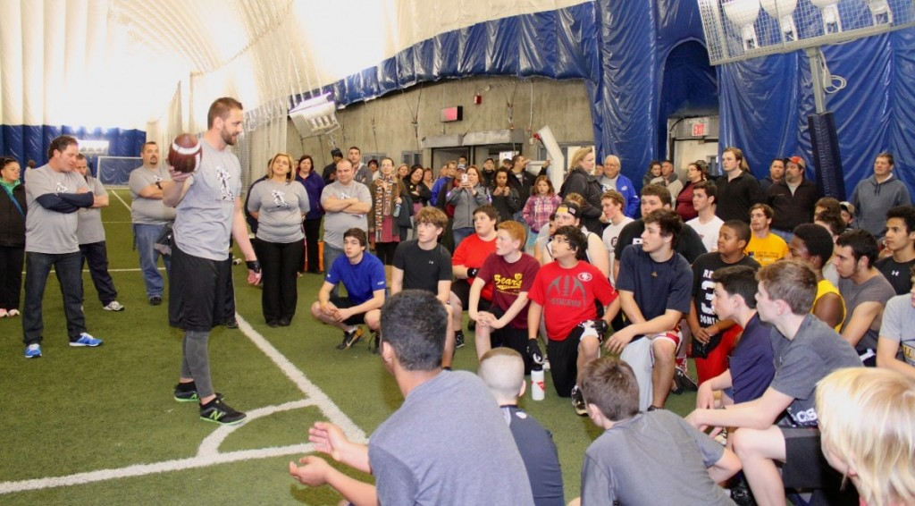Warrior Alum and Ottawa REDBLACKS captain Justin Phillips with the camp participants