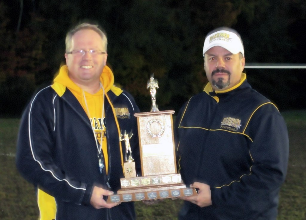 Paul Stewart (President) presents Michael Polito (Mosquito Head Coach) with the 2012 NCAFA O.C.M.F.A Trophy  (Mosquito Western Conference Championship Trophy)