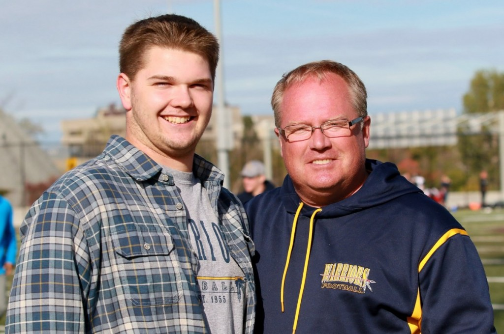 Warrior alumni Tyler Scott receives his Bell Warriors Jim Wagdin Post-Secondary Scholarship at the Inaugural Warriors Homecoming Day from Warrior President Paul Stewart