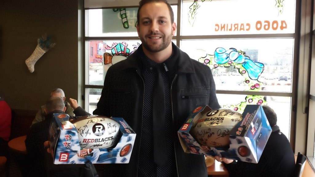 Justin Phillips (Warrior Alumni, Vanier Cup Champion, Grey Cup Champion, Warrior Hall of Famer) with his two donations to the 4th Annual Bell Warriors Fundraiser Silent Auctions. THANK YOU JUSTIN!