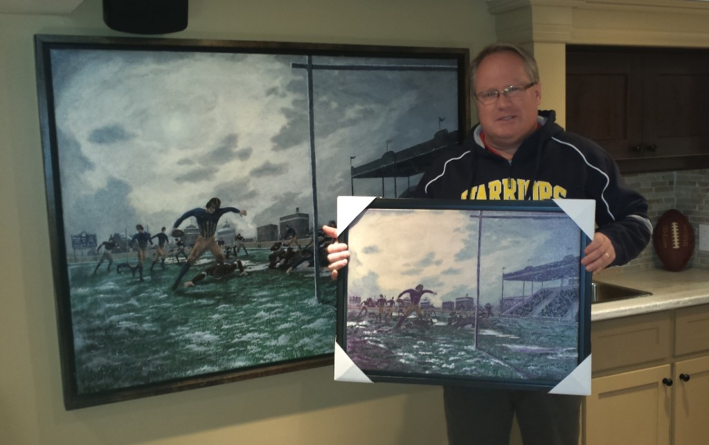 "Paul Stewart with the original ""The Touchdown"" painting and the donated print by Dave Rheaume."